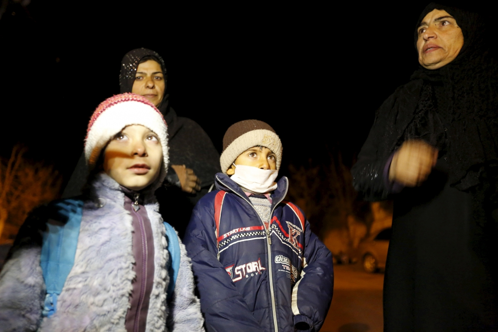 Residents who say they have received permission from the Syrian government to leave the besieged town depart after an aid convoy entered Madaya, Syria, on January 11, 2016. REUTERS / Omar Sanadiki