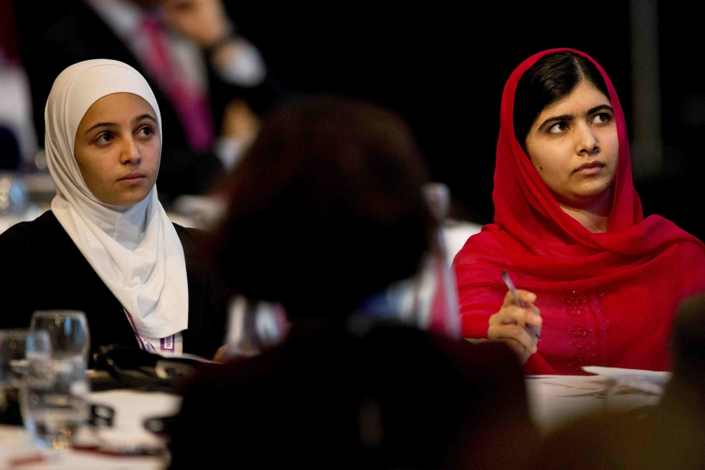 Nobel Peace Prize winner Malala Yousafzai (right) and 17-year-old Syrian refugee Mazoun Almellehan listen to speakers during the first focus event on education at the donors Conference for Syria in London on February 4, 2016. REUTERS / Matt Dunham / Pool